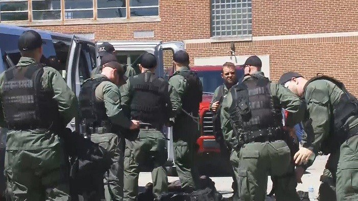A SWAT team has been activated in the slaying of eight family members in Piketon, Ohio.