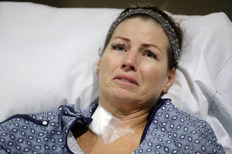 Natalie Vanderstay answers questions from her hospital bed at University Medical Center on Tuesday, Oct. 3, 2017, in Las Vegas. (AP Photo/Gregory Bull)