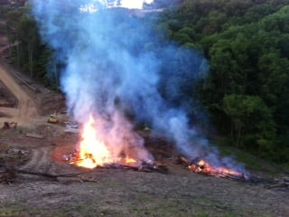 Piles of debris burning at about 9 p.m. at the site of the new Edgewood School site. Photo courtesy of Sarah Sullivan