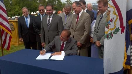 Gov. Earl Ray Tomblin signing the documents establishing the Blue Ribbon Commission. Source: Department of Transportation via Twitter