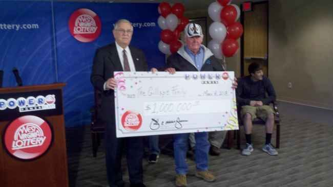 Photo of the Gillispie family accepting their $1 million check