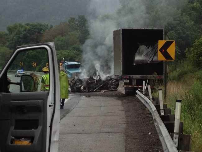 Smoking wreckage from a tractor trailer accident on I-77 near Cheylan exit