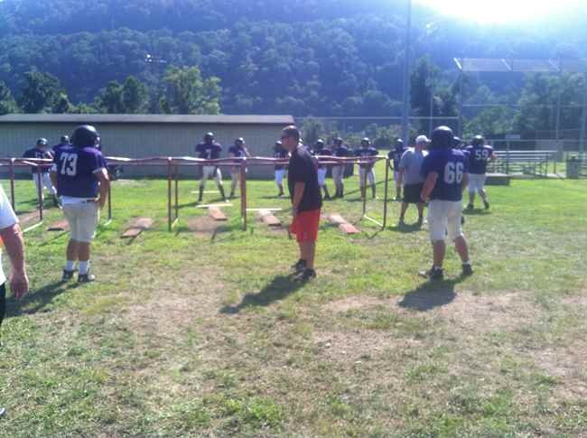 New coach Steven Freeman has his team run drills.