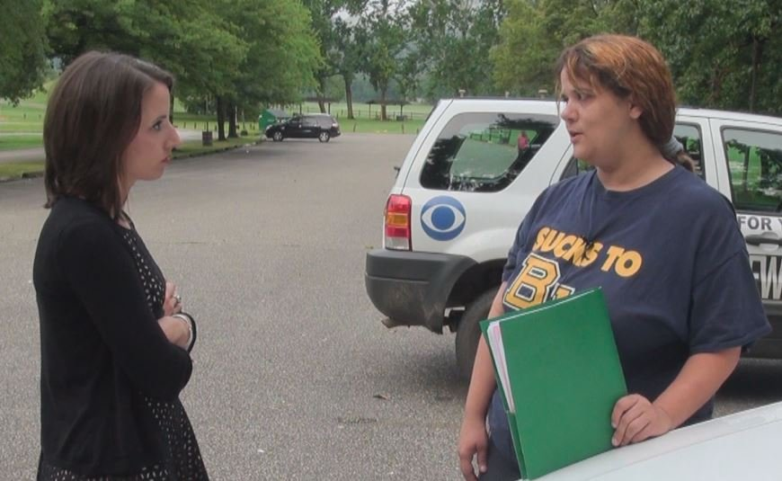 Rebecca Meninger speaking to reporter Lisa Robbins about her wait for clothing vouchers