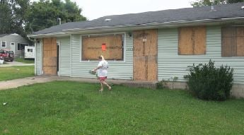 The home of the Quillen family after it was boarded up for decontamination.