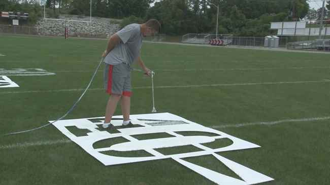 Paint getting added to the Steve Edwards Field Wednesday afternoon