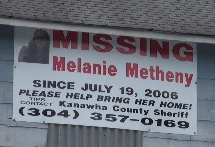 Posters of missing Kanawha County woman still hang from homes