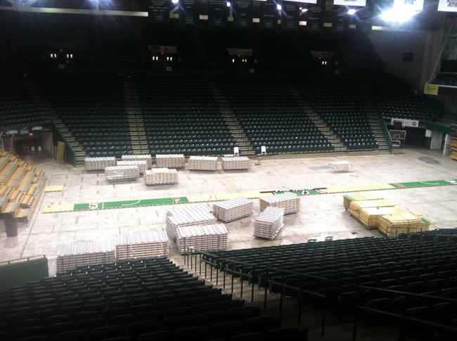 New floor being laid down at the Cam Henderson Center on the campus of Marshall University