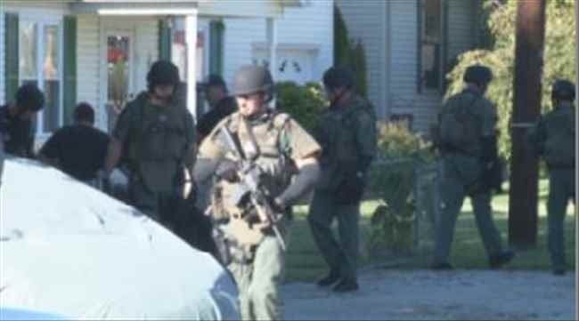 Police searching house for drug activity