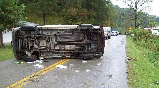 Kenneth R. Lash's Ford Explorer on its side after the crash.