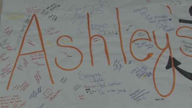 Signatures from students and staff on a banner for Ashley Dennison