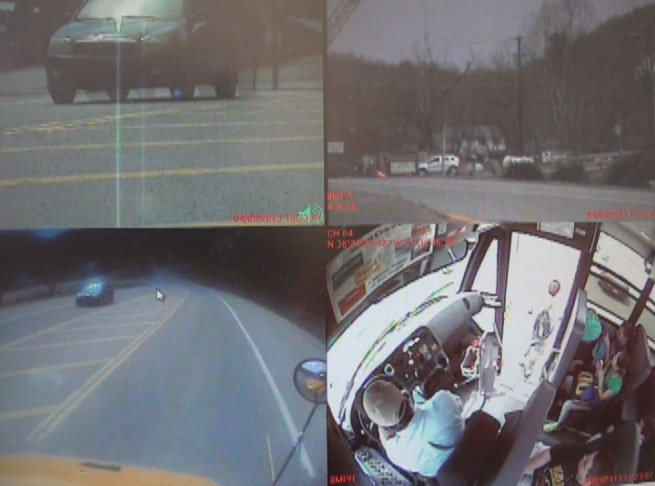Camera records vehicle passing stopped school bus.