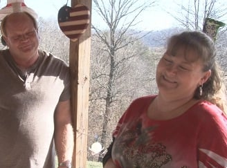 Kimberly and Joe Boggess outside of their Sandyville, WV home.