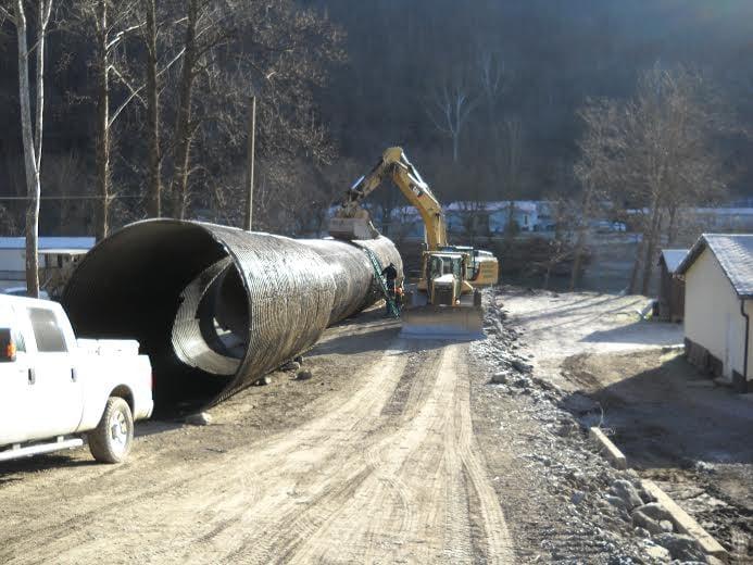 Crews work to complete the Madison Creek Causeway in Logan, WV