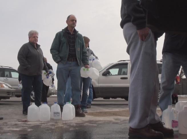 People wait in line for bulk water.