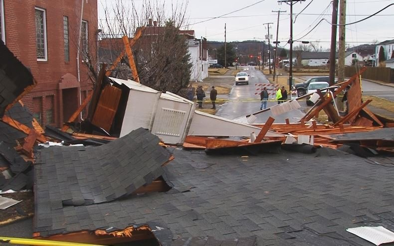 Strong winds ripped off the roof and steeple at Open Door Baptist Church in Huntington, WV.