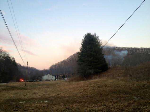 Brush fire in Sissonville, WV burns 12 acres. Homes in the area were threatened but did not sustain damage.