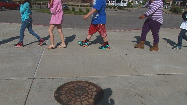Children walking outside of a school in Charleston, WV.
