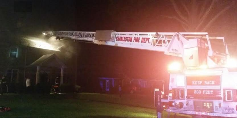 Fire rescue crews used a ladder truck to determine if flames spread to attic of Kanawha City home after a fire started in the garage of the residence late Monday evening.