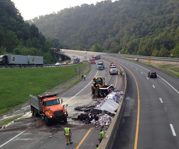 A overturned tractor trailer on I-77 southbound spilled beer all over the roadway and caused delays.