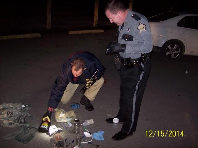 Police say they found paraphernalia and active meth labs in a car.