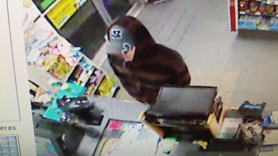 Police are looking for this man, wanted for attempted armed robbery at two Huntington convenience stores.