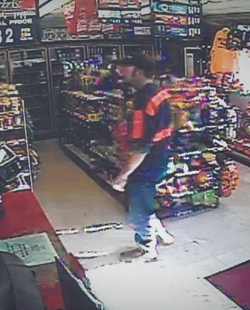 Suspect walking into gas station