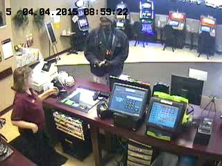 Police are searching for the man in this photo who is suspected of cashing in stolen lottery tickets in the Charlseton, WV area.