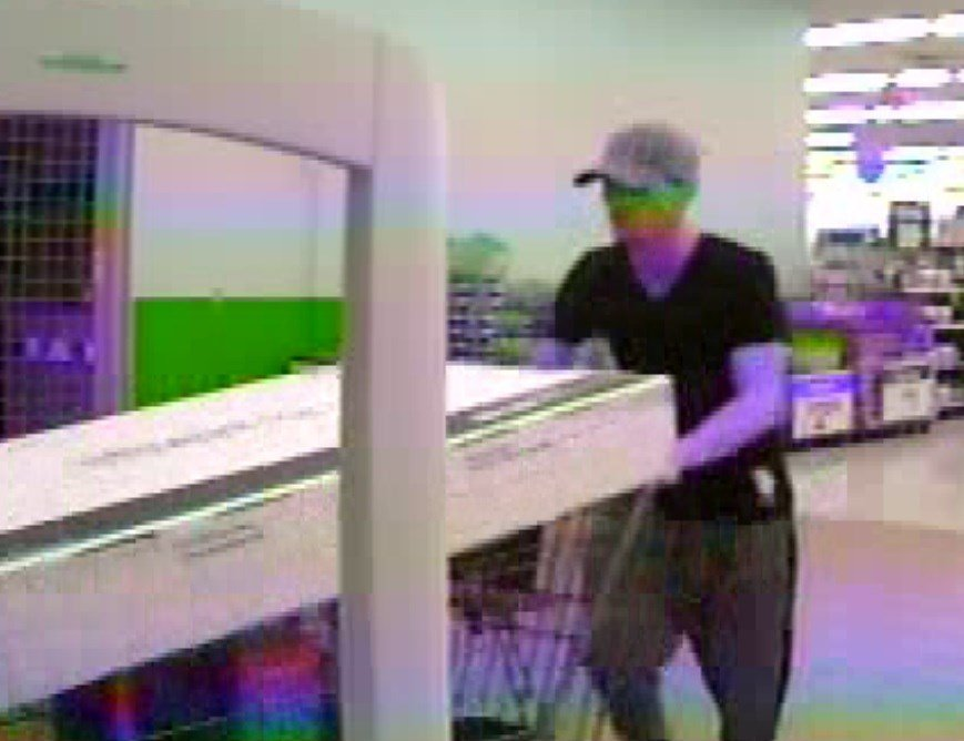 Police are looking for this man after he used a stolen credit card for $1,800 worth of merchandise.