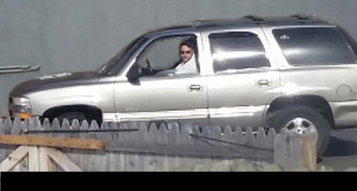 Police are looking for this man after two young girls said he tried to get them to get in this SUV.