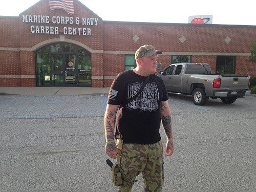 Michael LeRose stands guard in front of the Marine Recruitment Center in South Charleston, WV.