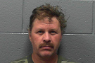 Darrin Stollings arrested after staff members say he threatened and pulled a knife on them.
