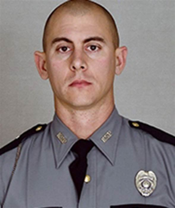 Trooper Joseph Cameron Ponder, 31, was conducting a traffic stop Sunday night around 10:20 p.m. on Interstate 24 when the driver fled, Kentucky State Police said in a news release. (Courtesy: Kentucky State Police)